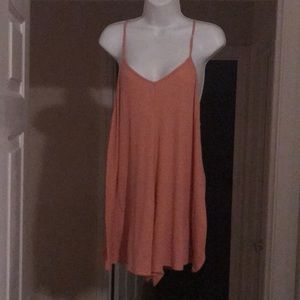 Simple peach colored romper by Free People